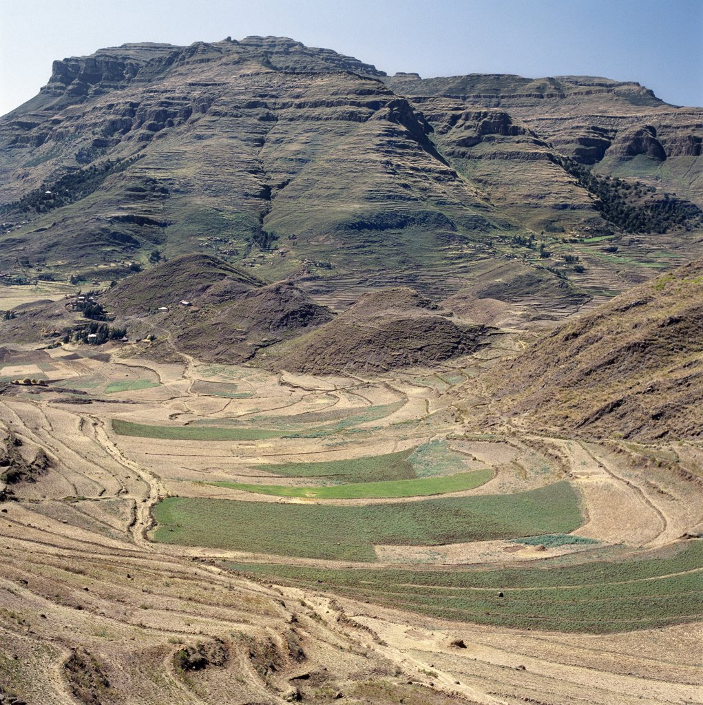 Stock Photo: 4272-10156 Ethiopia is a land of vast horizons and dramatic scenery.  The weathered mountains in the Ethiopian Highlands exhibit layer upon layer of volcanic material, which built the plateau into Africas most extensive upland region.
