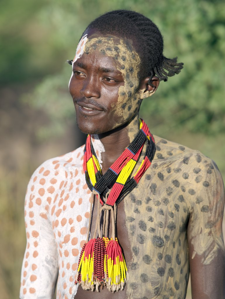 The Karo excel in body art. Before dances and ceremonial occasions, they decorate their faces and torsos elaborately using local white chalk, pulverised rock and other natural pigments. Young men like their hair braided in striking styles.The Karo are a small tribe living in three main villages along the lower reaches of the Omo River in southwest Ethiopia. : Stock Photo