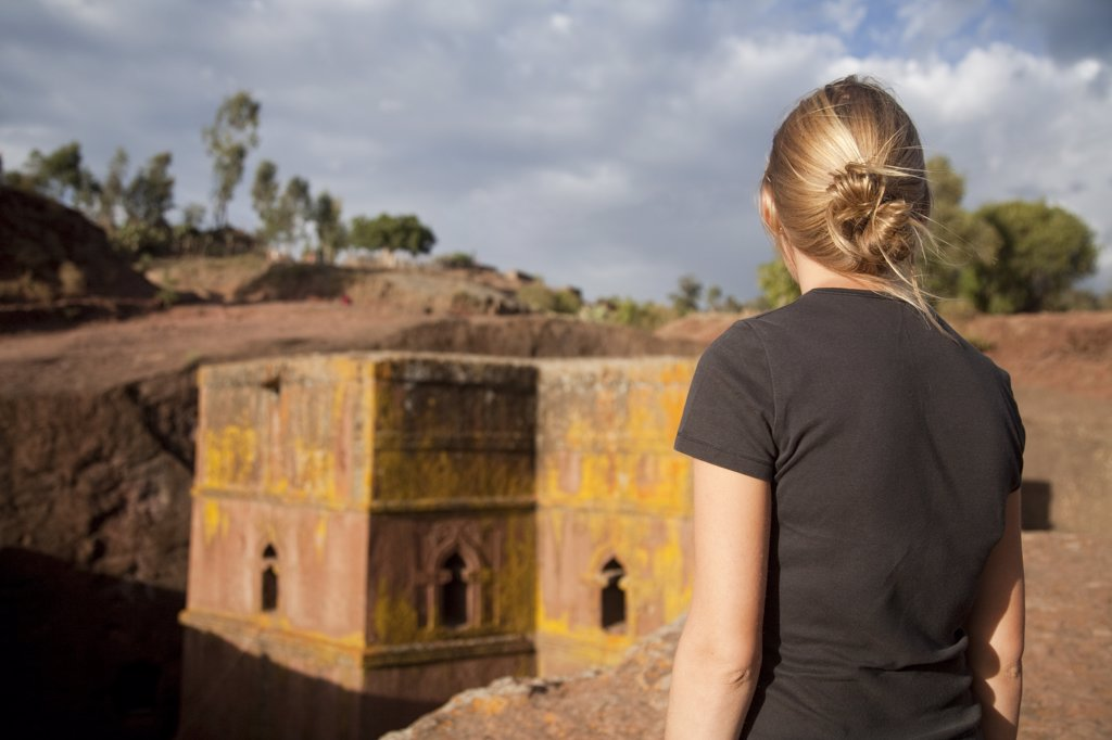 Stock Photo: 4272-10871 Ethiopia, Lalibela, Bet Giyorgis. A tourist gazes at the rock-hewn church of Bet Giyorgis. (MR)