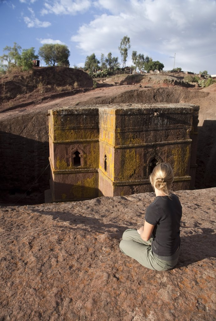 Stock Photo: 4272-10873 Ethiopia, Lalibela, Bet Giyorgis. A tourist gazes at the rock-hewn church of Bet Giyorgis. (MR)
