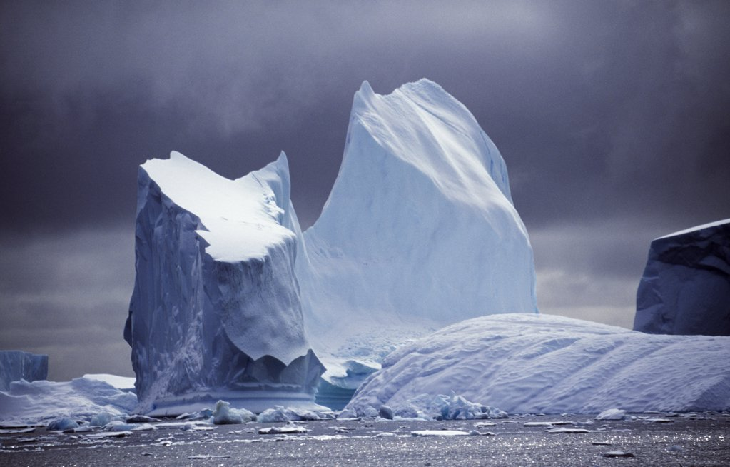 Antarctica, Grandidier Channel, Pleneau Island. Grounded iceberg. : Stock Photo