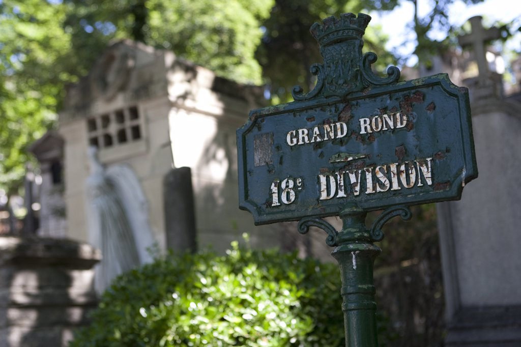 Stock Photo: 4272-11359 Paris, France. Detail of a crypt and plot marker in the Pere Lachaise cemetery in Paris