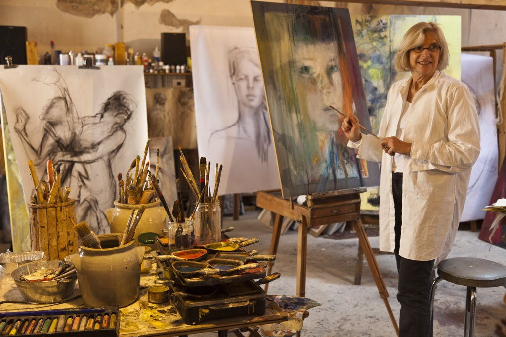 France, Tarn, Soreze.  Catherine Huppey in her artist's studio, L'Atelier du Pont Vaillant, Soreze. : Stock Photo