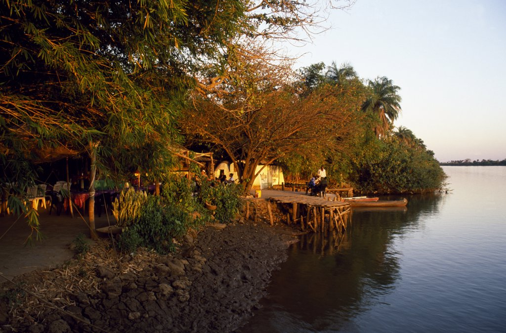 Stock Photo: 4272-11795 Janjang Bureh Camp's riverside setting at Lamin Koto on the north bank of the Gambia River is idyllic.