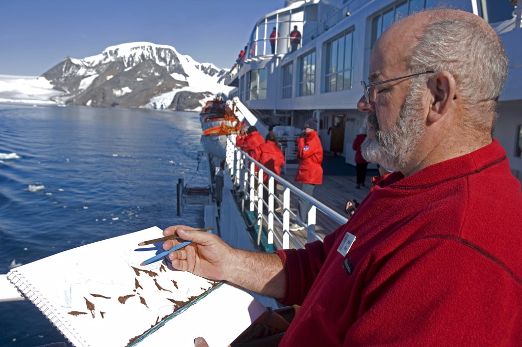 Stock Photo: 4272-1184 Antarctica, Antarctic Peninsula, Antarctic Sound.  Entering the bay in which the ex-British station and the permanently manned now Argentinian base of Hope Bay exists. Australian artist Noel Miller captures the scene.