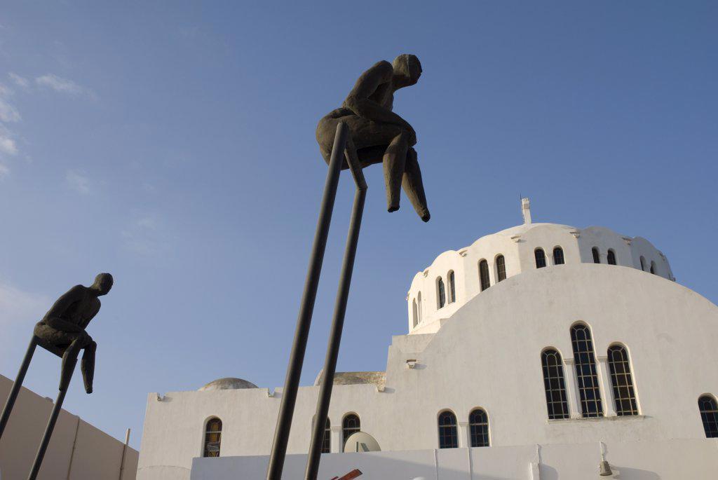 Stock Photo: 4272-12716 Greece, Santorini, Fira.  Sculptures in the clifftop town of Fira