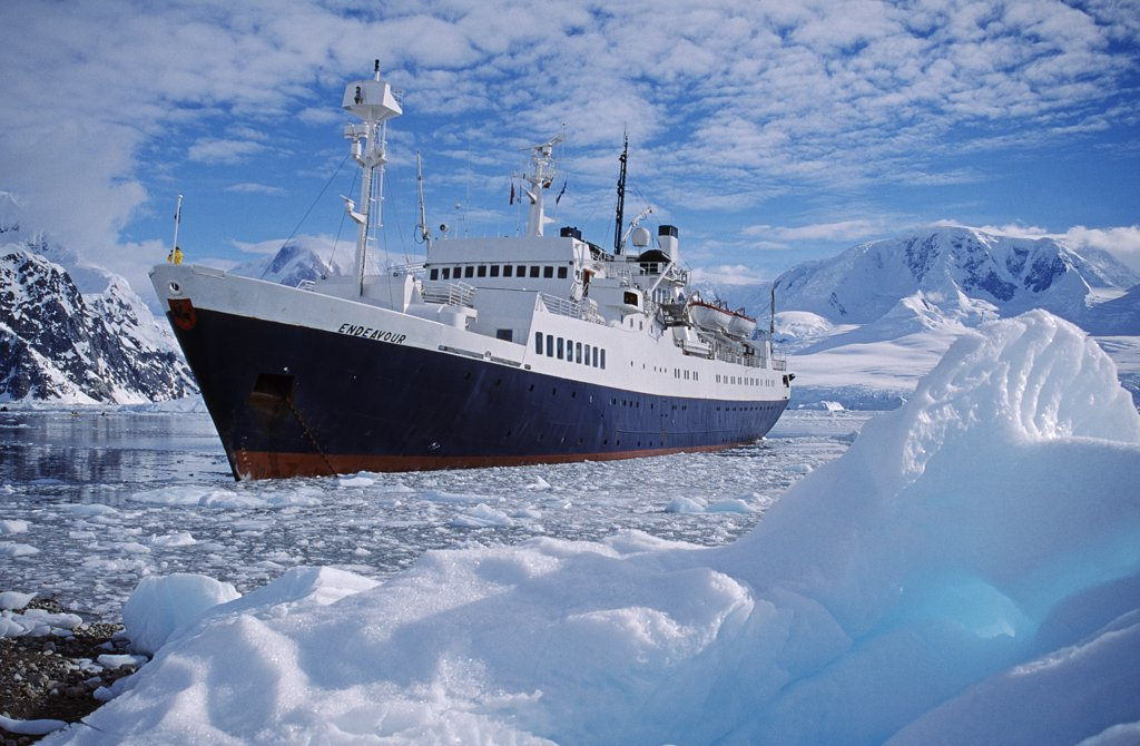 Antarctica, Andvord Bay, Neko Harbour. Tourist expedition ship 'Endeavor' anchored amongst ice : Stock Photo