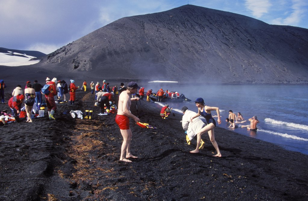 Antarctica, South Shetland Islands, Deception Island. Cruise vessel tourists bathing in volcanically heated water : Stock Photo