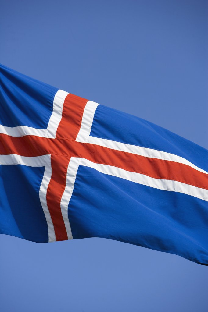 Stock Photo: 4272-13203 Iceland, the countries distinctive flag show its colours in a stiff Reykjavik wind.