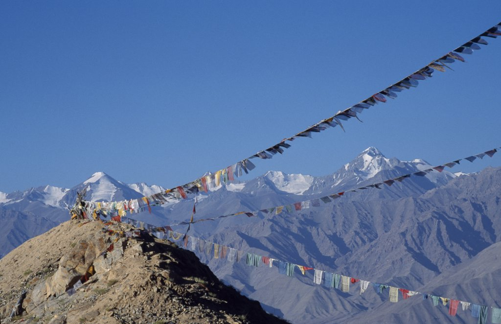 Stock Photo: 4272-13346 Stok Mountains and prayer flags viewed from Leh.  Stok Kangri trekking peak prominent on right