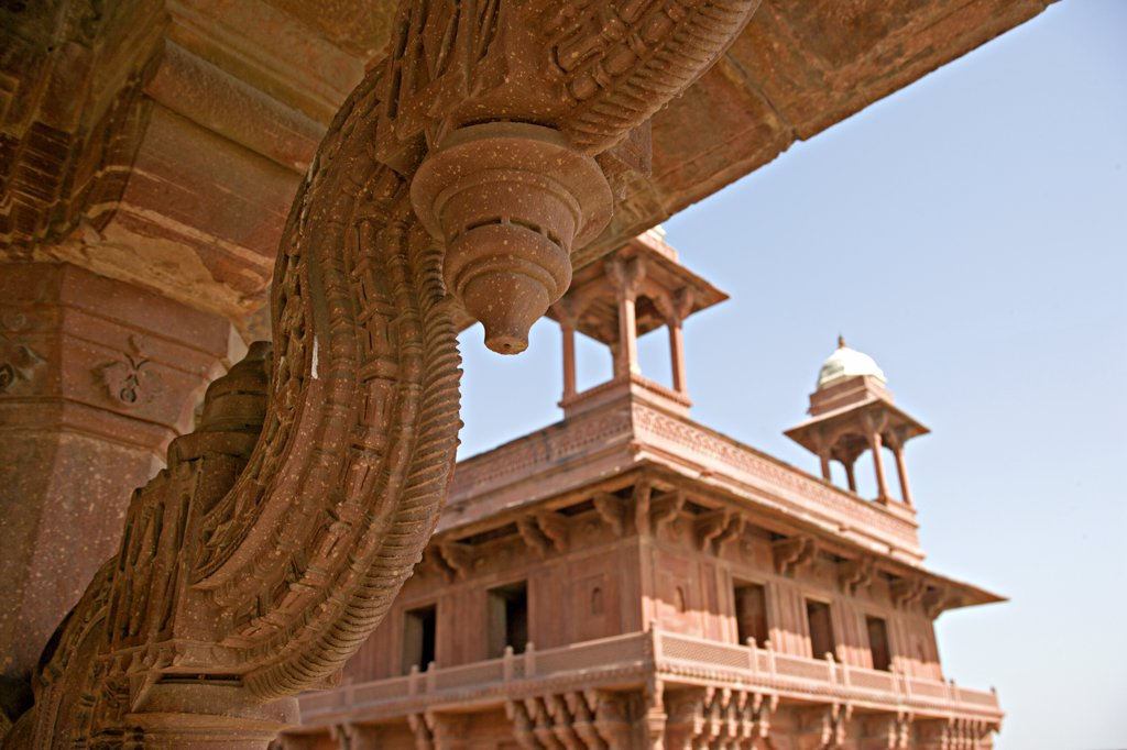 Stock Photo: 4272-13708 Architectural detail of ornately carved stone roof line, looking towards the Diwan-I-Kas is also known as the The Jewel House or the Ekstambha Prasada (Palace of Unitary pillar). Uttar Pradesh, Fatehpur Sikri, Agra District. India.
