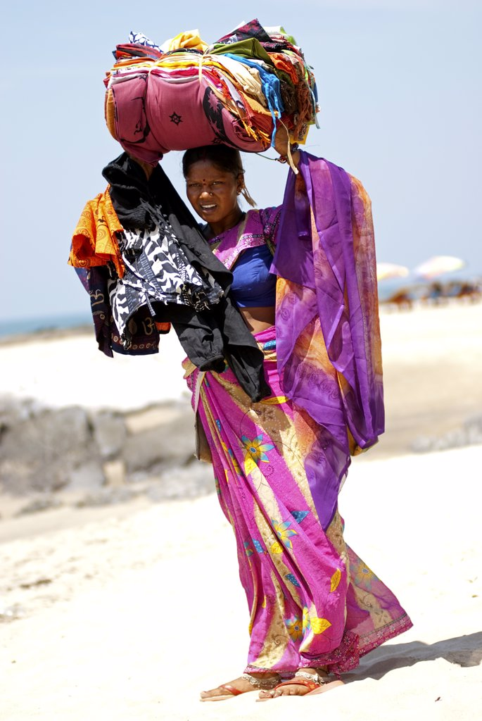 Stock Photo: 4272-13926 India; Goa. Woman trader on Vigator Beach.