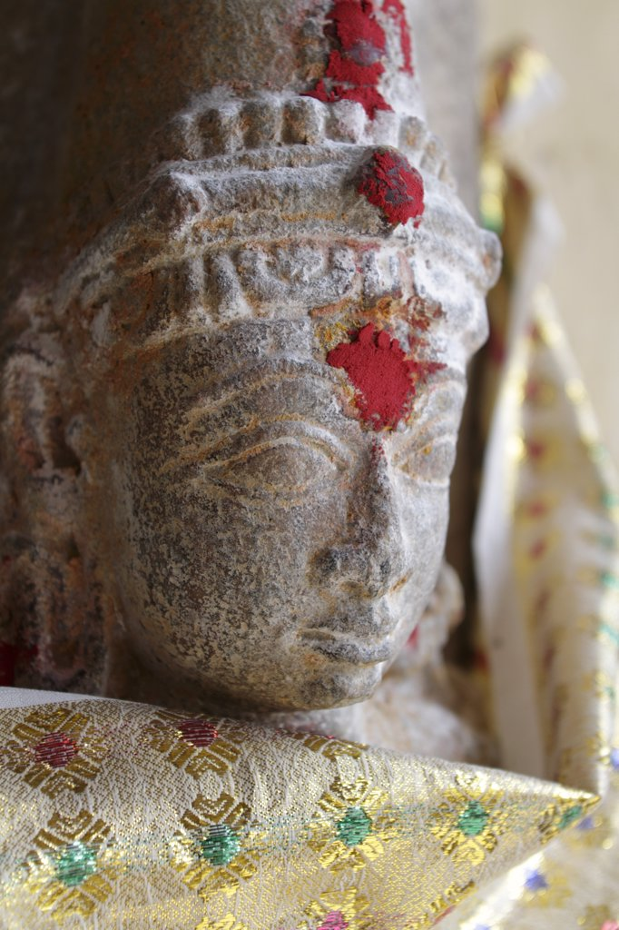 Stock Photo: 4272-14168 India, Tamil Nadu, Madurai. Deity at a shrine in the Minakshi Sundareshvara Temple.