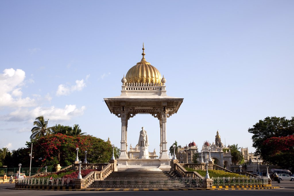Stock Photo: 4272-14267 India, Mysore. A statue of the Maharaja Krishnaraja Wodeyar in the centre of a roundabout in Mysore, with Mysore Palace in the background.