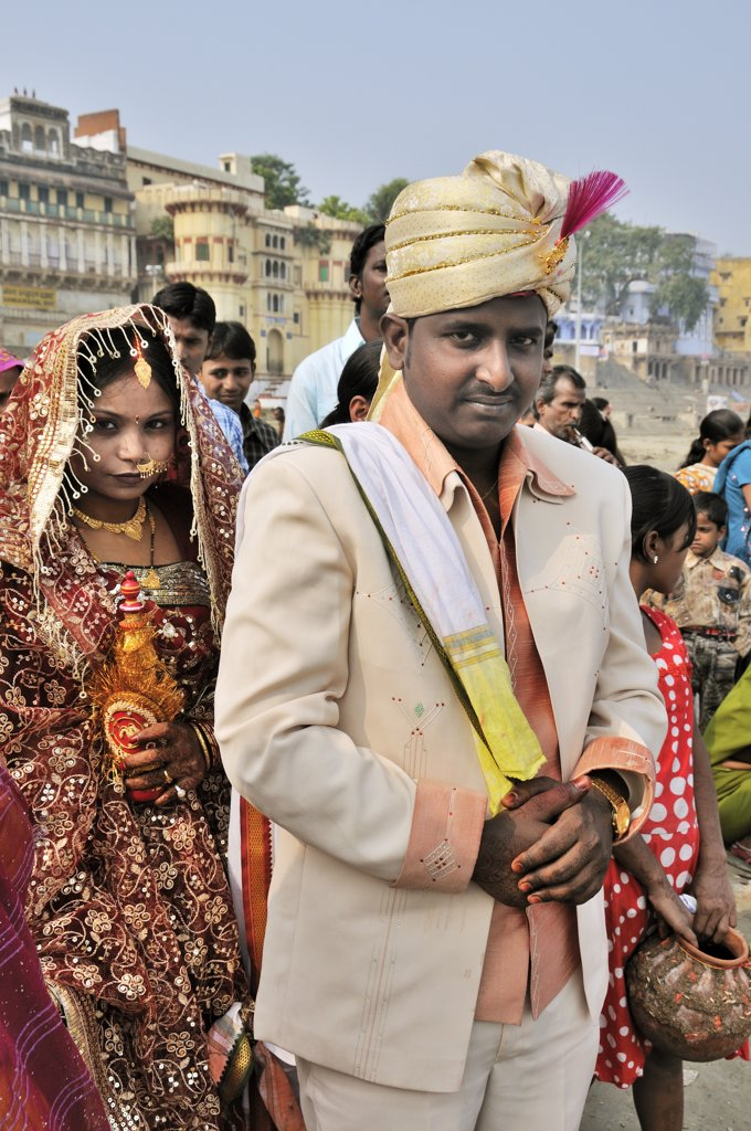 Stock Photo: 4272-14404 The grooms in a marriage on the banks of the Ganges river. Varanasi, India