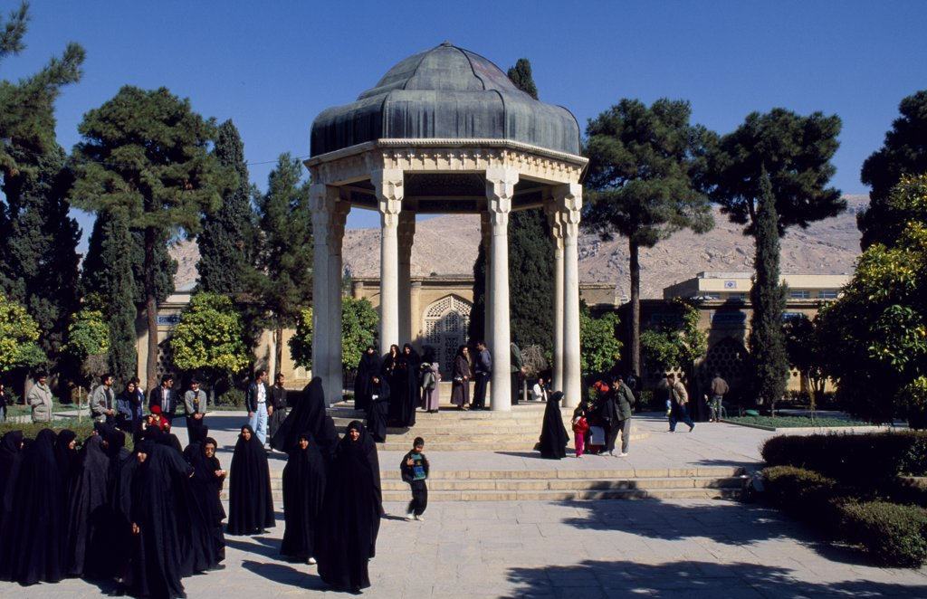 Stock Photo: 4272-14508 Iran, Shiraz. Aramgah e Hafez, tomb of the celebrated poet Hafez, Shiraz.  Shams ad Din Mohammed, or Hafez he who knows the Quran by heart, wrote some 600 ghazals.  The marble tombstone, engraved with a long verse from the poets works was placed here, inside a small shrine.