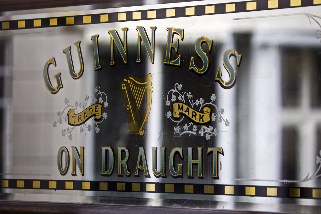 Stock Photo: 4272-14582 Ireland, Dublin, Portobello, Guinness Draught sign on the doors of the Bleeding Horse pub.