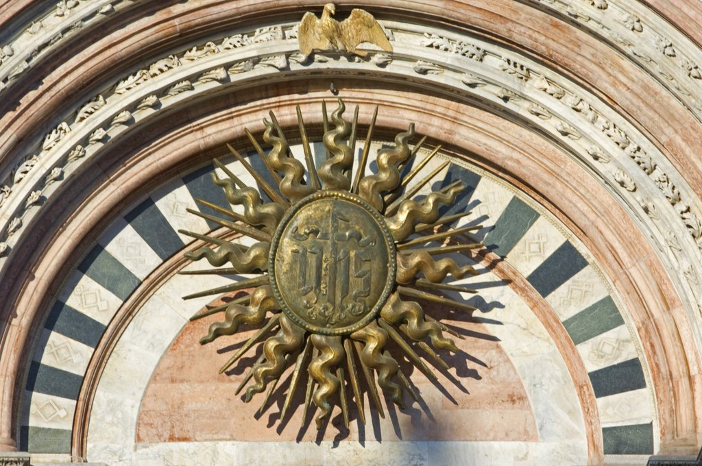 Stock Photo: 4272-15037 Italy, Tuscany, Siena. The Sun Symbol, also the symbol of the risen Christ on the facade of the Duomo, Siena's Gothic cathedral.