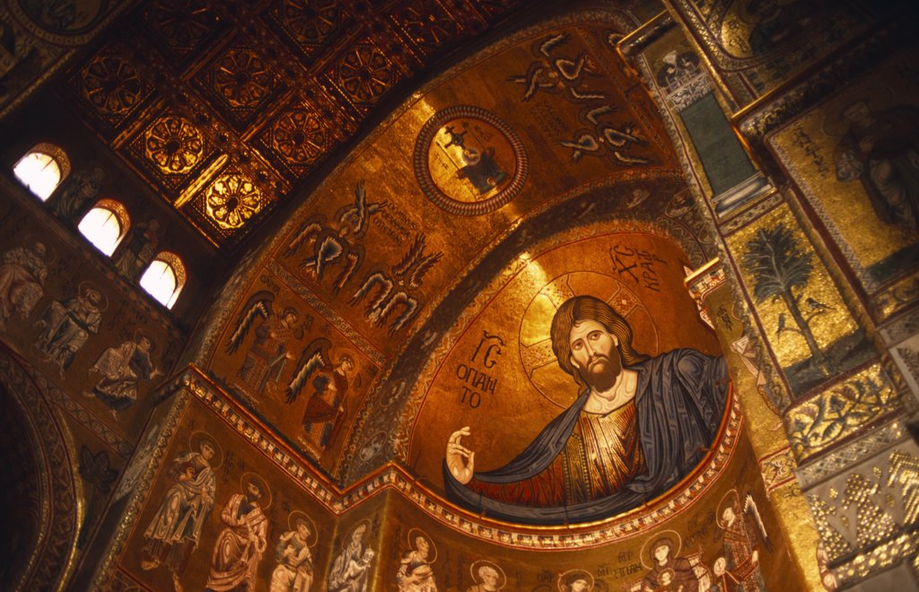 Italy, Sicily, Palermo, Monreale. The Cathedral of Monreale - the interior Mosaics. The cathedral is one of the masterpieces of Norman-Sicilian architecture, begun in 1174 by William II of Sicily. The cathedral has fine copper doors by Bonanno Pisano and its interior is decorated with exceptional Byzantine mosaics. : Stock Photo