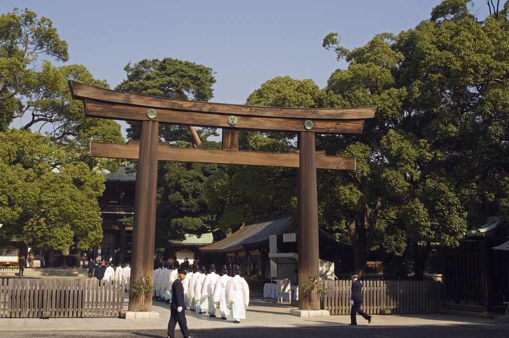 Meiji Jingu Shrine procession of temple priests under Torii Gate : Stock Photo