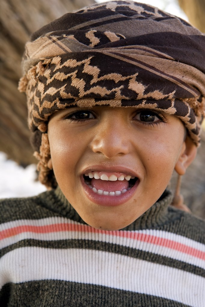 Stock Photo: 4272-15927 Jordan, Finan.   Beduin boy smiles and poses for the camera.