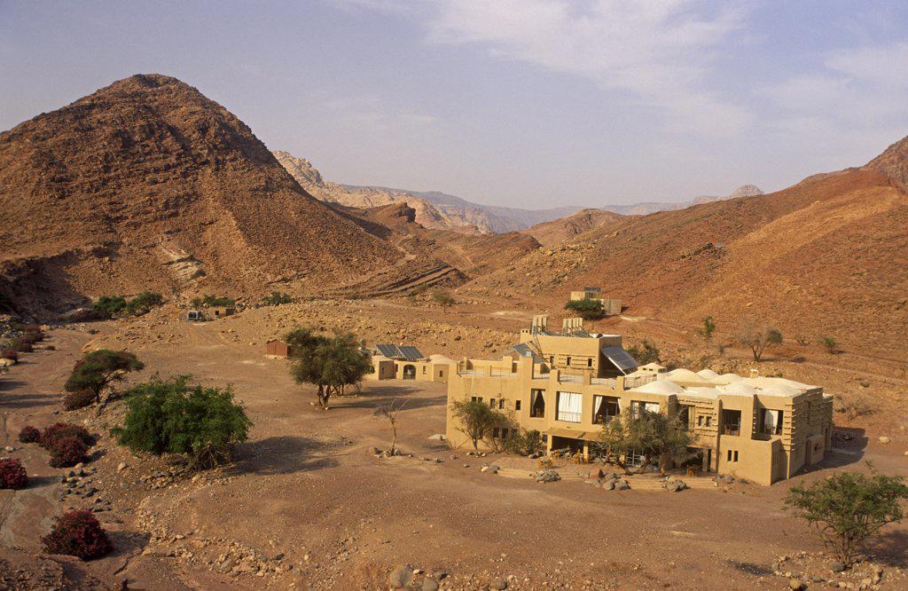 Stock Photo: 4272-16044 Jordan, Dana Biosphere Reserve, Wadi Feynan. The remote Feynan Eco-lodge stands amidst desert scenery near the confluence of Wadi Feynan and Wadi Araba.
