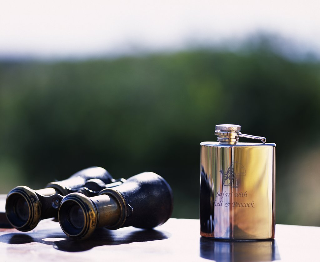 Stock Photo: 4272-16156 Hip-flask & binoculars at Tortilis Camp.