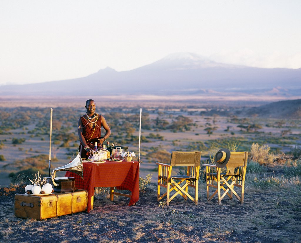 Stock Photo: 4272-16157 Sundowners in style with a view of Mt.Kilimanjaro on an evening game drive from Tortilis Camp.