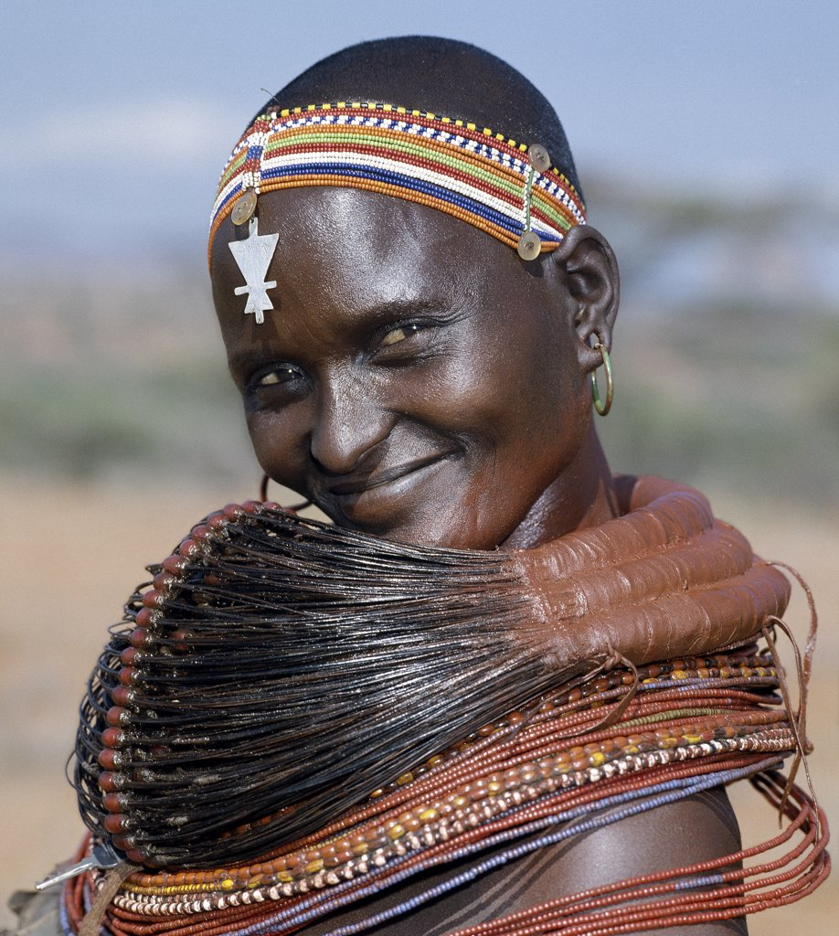 Stock Photo: 4272-16204 A Samburu woman wearing a mporro necklace, which denotes her married status.  These necklaces were once made of hair from giraffe tails but nowadays, the fibres of doum palm fronds are used instead.