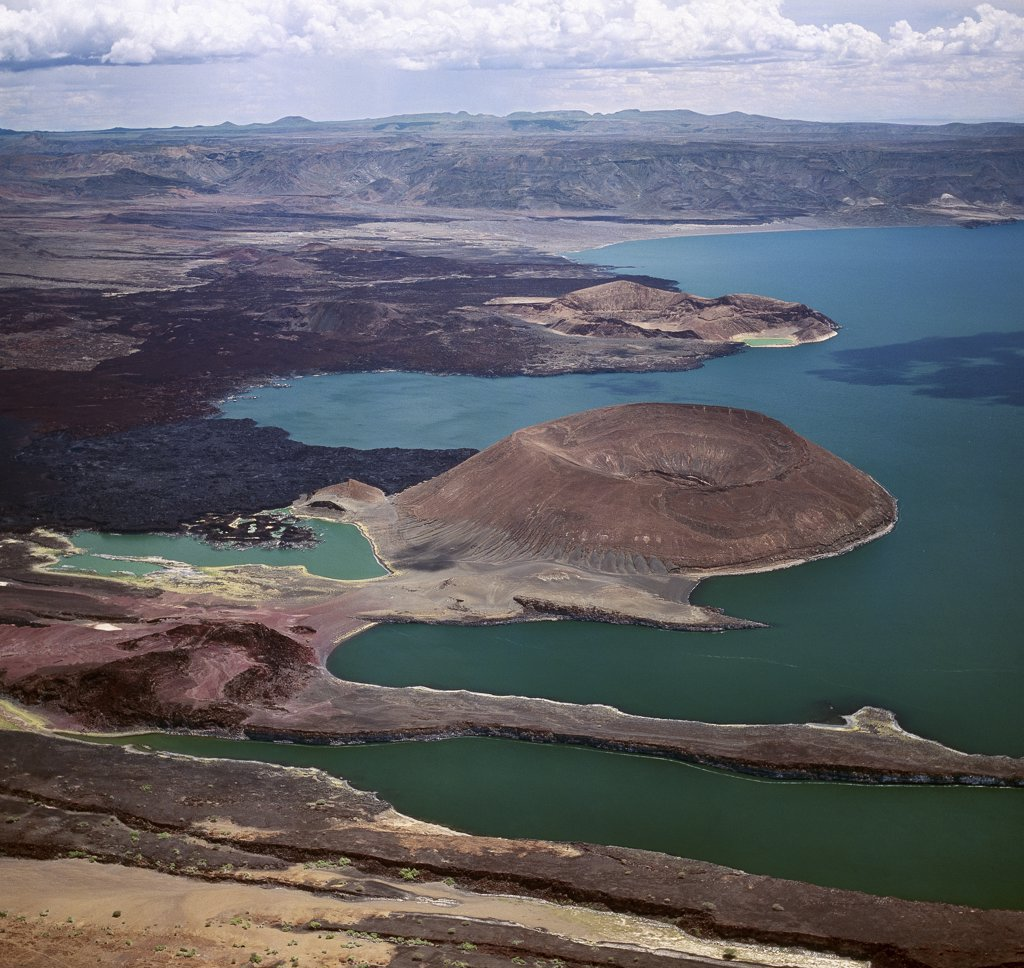 An aerial view of the southern end of Lake Turkana, which is named Von Hhnel Bay after the Austrian naval officer who was part of an epic journey of exploration to reach the lake in 1888.The remarkable colour of the lakes alkaline water is caused by green algae with high chlorophyll concentrations. : Stock Photo