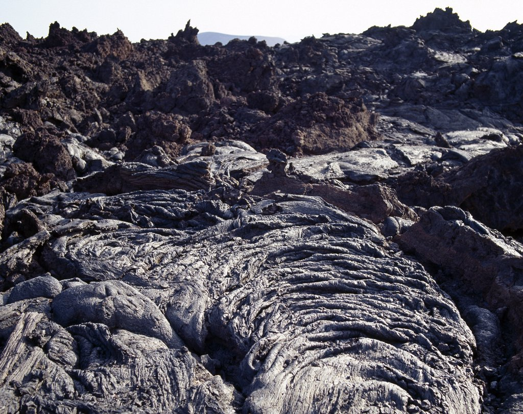 Stock Photo: 4272-16263 Lava flows from Teleki's Volcano.  Named after Count Teleki, an Austrian nobleman,  who led the first European expedition to the region in 1888,  the volcano last erupted in about 1895 - the only active volcano in the region at that time. Over centuries, each eruption ejected  basaltic lava of a different colour. The flows in the foreground still look remarkably fresh.