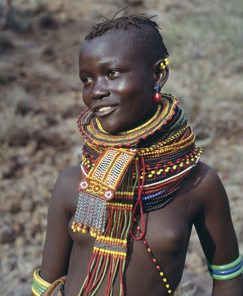 A young Turkana girl adorned with necklaces of a style the Southern Turkana prefer to wear. : Stock Photo