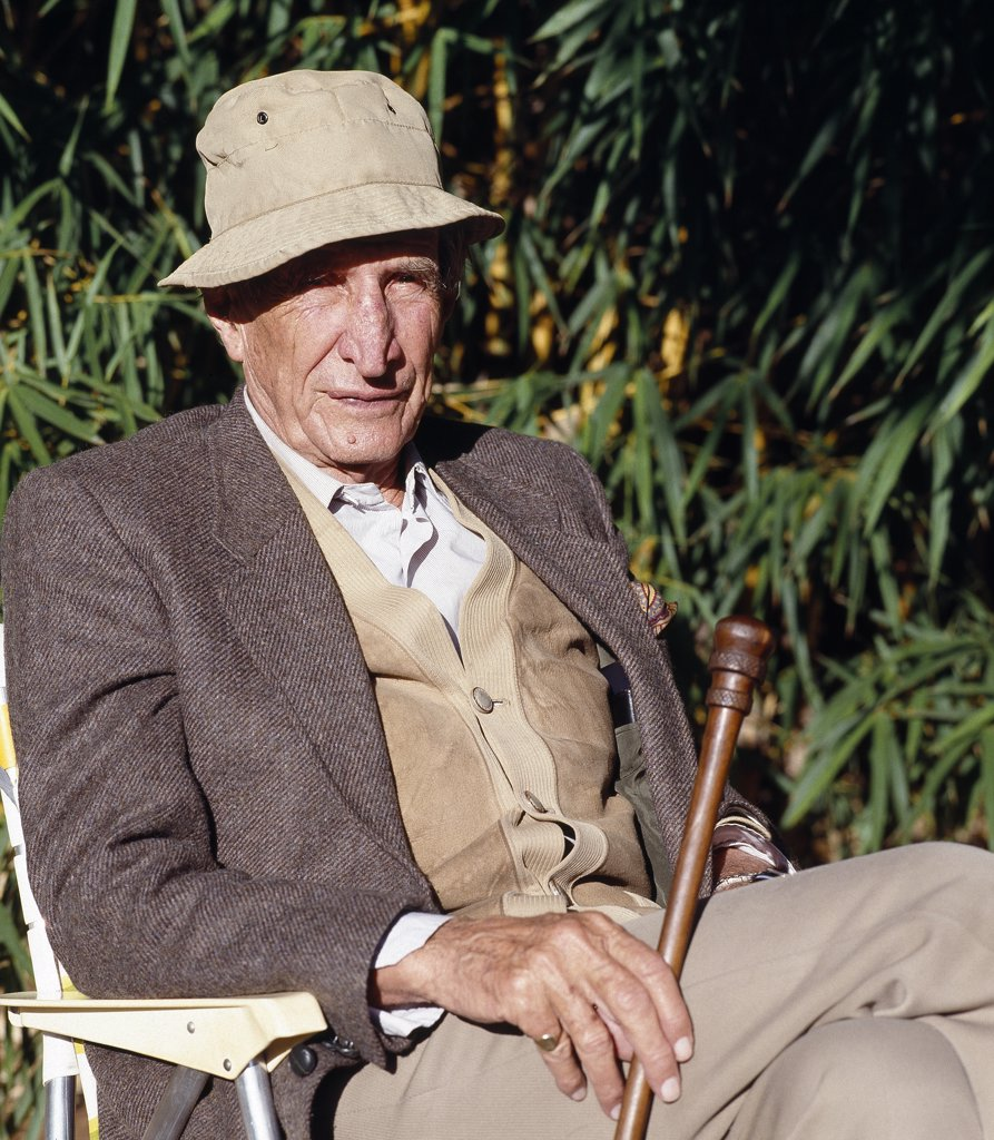 Stock Photo: 4272-16586 Sir Wilfred Thesiger, the famous 20th century explorer and author, relaxes on safari in Kenya in 1990.