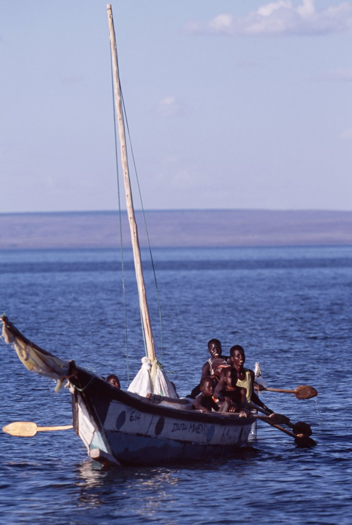 Local fishermen risk their lives when they go out on Lake Turkana in frail wooden boats powered by sails made from flour sacks and simple wooden paddles.  Lake Turkana is notorious for its sudden and violent winds. : Stock Photo