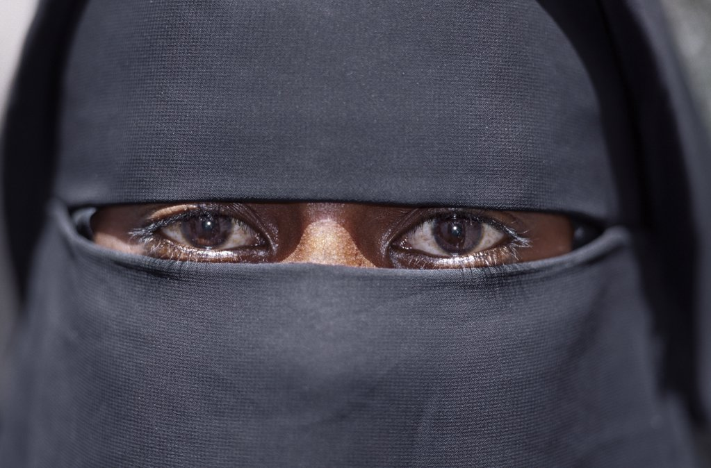 Stock Photo: 4272-17073 The eyes of a Lamu woman wearing a traditional black Islamic dress and face veil. Situated 150 miles north northeast of Mombasa, Lamu town dates from the 15th century AD.