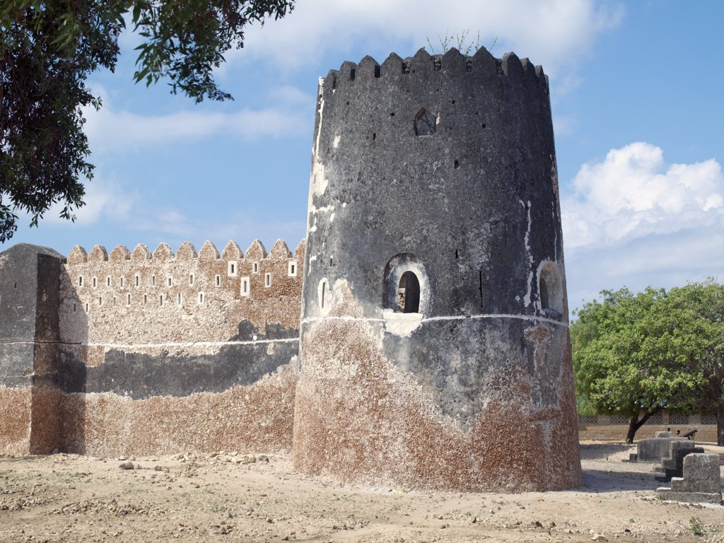 Stock Photo: 4272-17149 Siyu Fort. The Sultan of Zanzibar in the middle of the 19th century built this impressive fort at the end of the mangrove lined tidal channel leading to Siyu village on Pate Island. The fort is now undergoing extensive repairs after years of neglect.
