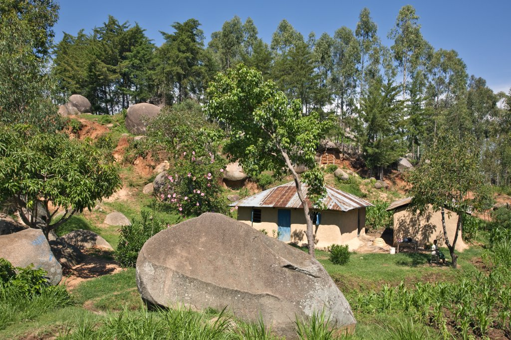 Kenya. A homestead nestling among giant granite boulders in Western Kenya. : Stock Photo