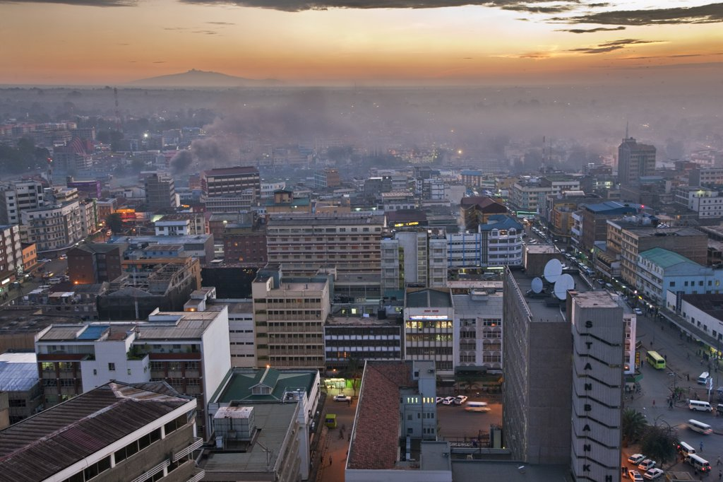 Stock Photo: 4272-17875 Kenya, Nairobi. Nairobi at daybreak with Mount Kenya rising in the far distance.