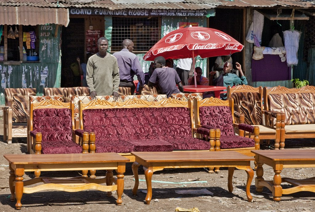 Stock Photo: 4272-17975 Kenya, Kisumu District. A furniture maker and upholsterer displays his various styles of sofa sets and tables on the roadside near Kisumu.