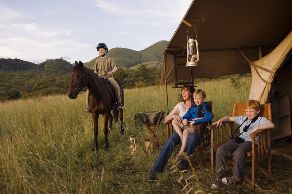 Kenya, Chyulu Hills, Ol Donyo Wuas.  Family on a riding safari with Ride Africa in the Chyulu Hills. (MR) : Stock Photo