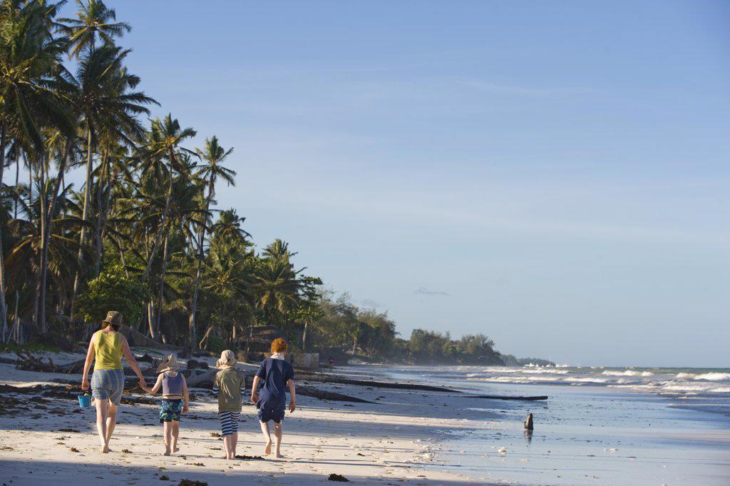 Stock Photo: 4272-18714 Kenya, Coast, Diani Beach.  Family enjoying the beach. (MR)