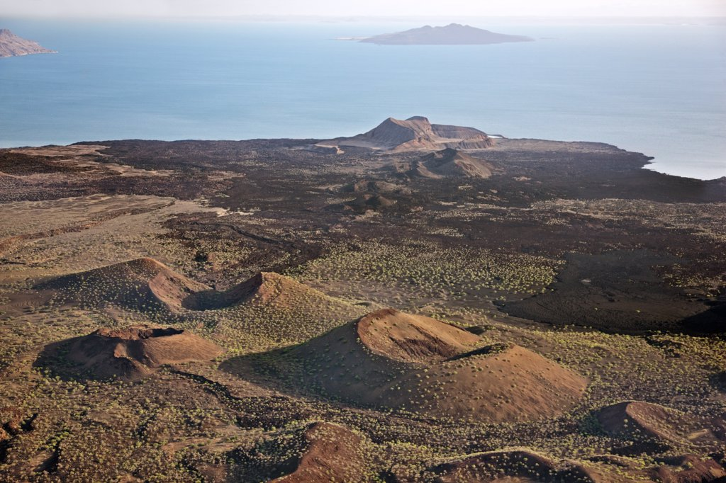 Stock Photo: 4272-19154 The lava barrier that separates the southern end of Lake Turkana from the Suguta Valley. South Island is in the distance while the extinct volcanic crater, Abil Agituk, is close to the lakeshore. The region is pockmarked with volcanic cones.