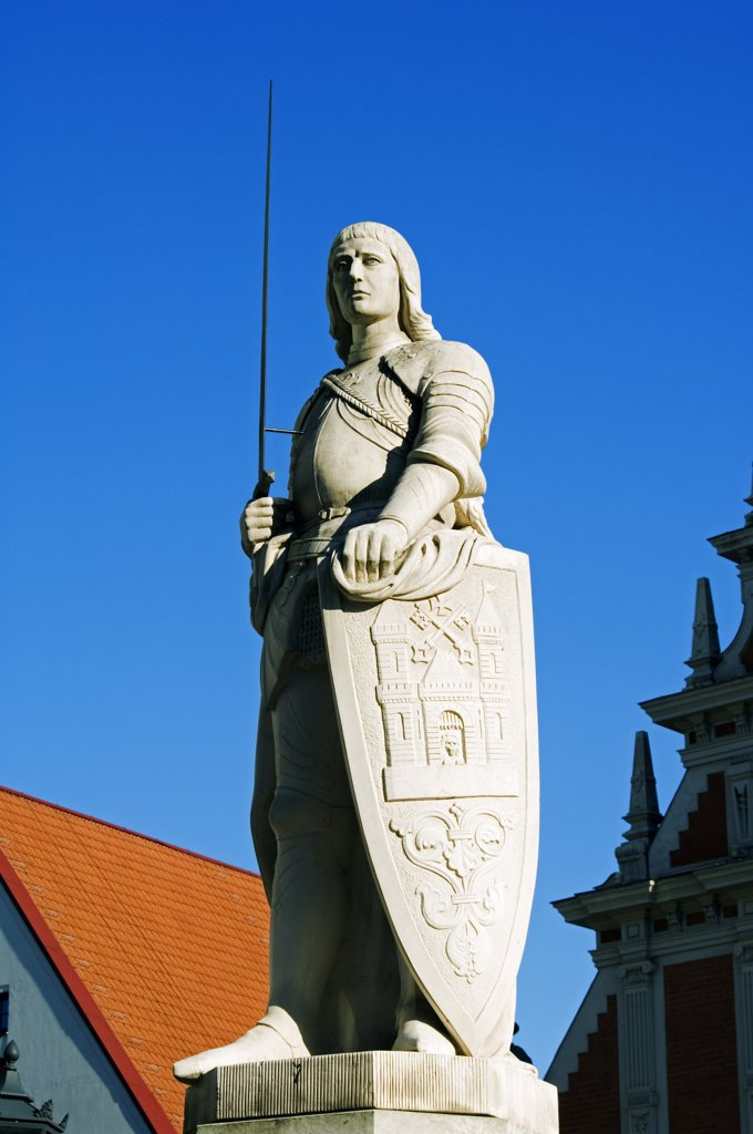 Stock Photo: 4272-19315 Statue of St Roland, Patron Saint of Riga, the statue is a replica of the original erected in 1897.The statue stands in front of St Peters Church a 13th Century Medieval Lutheran Church and the Museum and The House of Blackhead