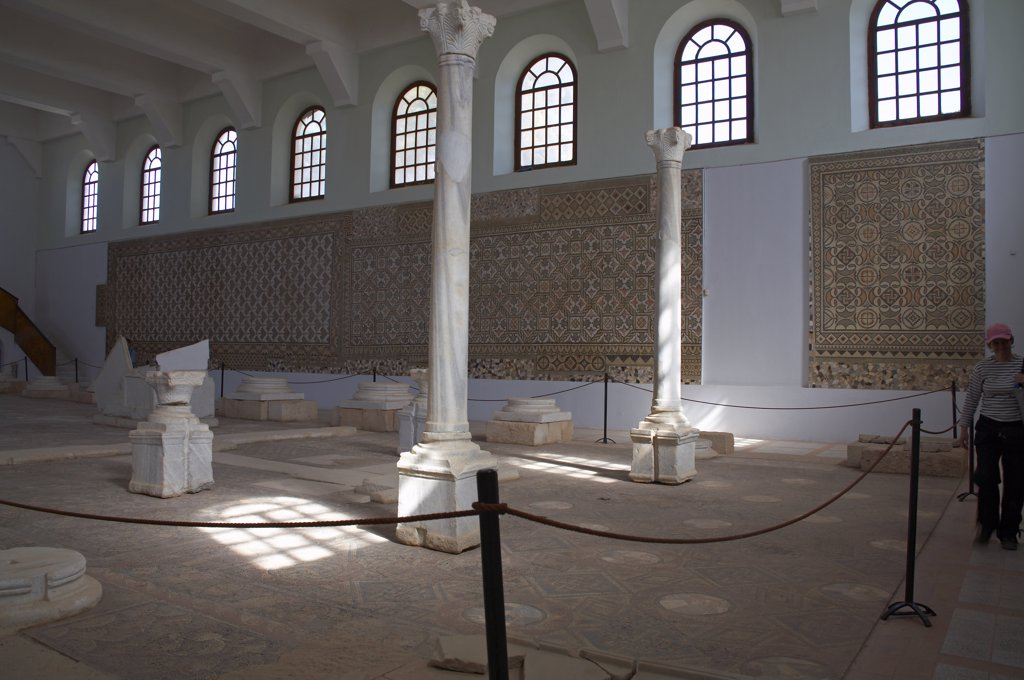 Interior of the Roman museum in Sabratha, Libya, with mosaics from the Basilica of Justinian on the walls and floor. The mosaic on the floor is from the central nave, and those on the walls from the basilica's two aisles. : Stock Photo