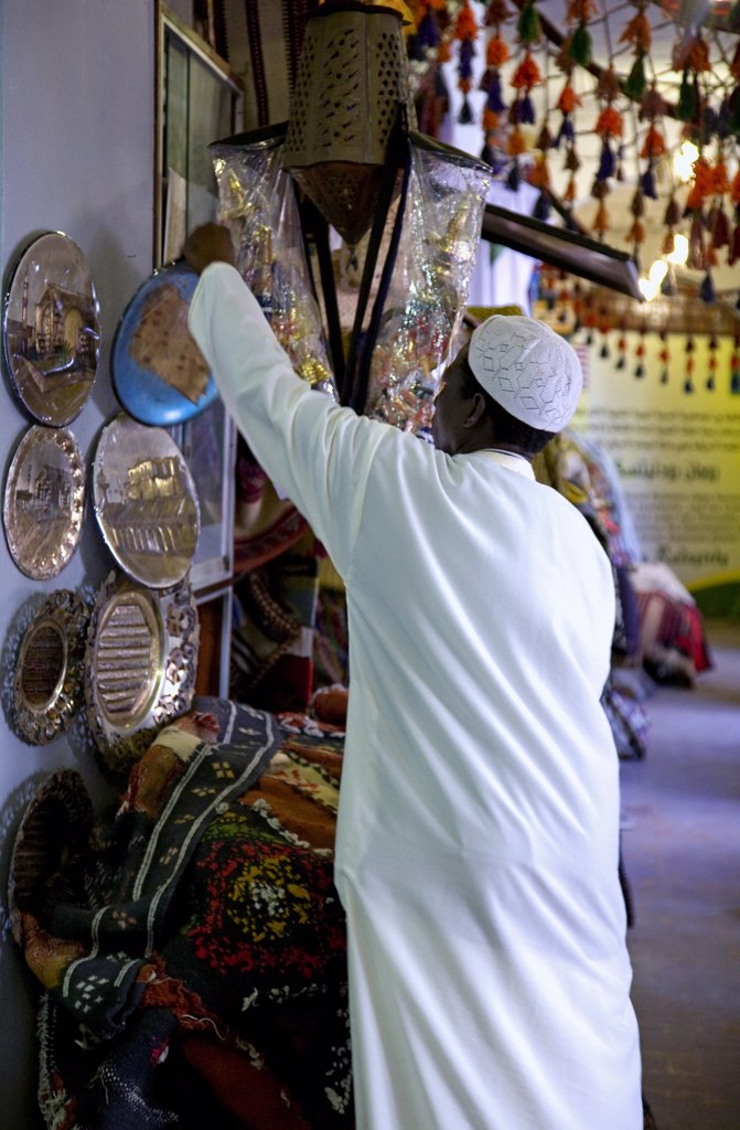 Tripoli, Libya; At the Ancient Medina of Tripoli a vendor putting a souvenir on display in one of the shops : Stock Photo