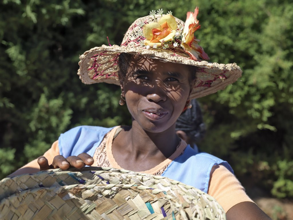 Stock Photo: 4272-20269 A woman wearing a decorated Malagasy hat sells baskets in Ambalavao market.
