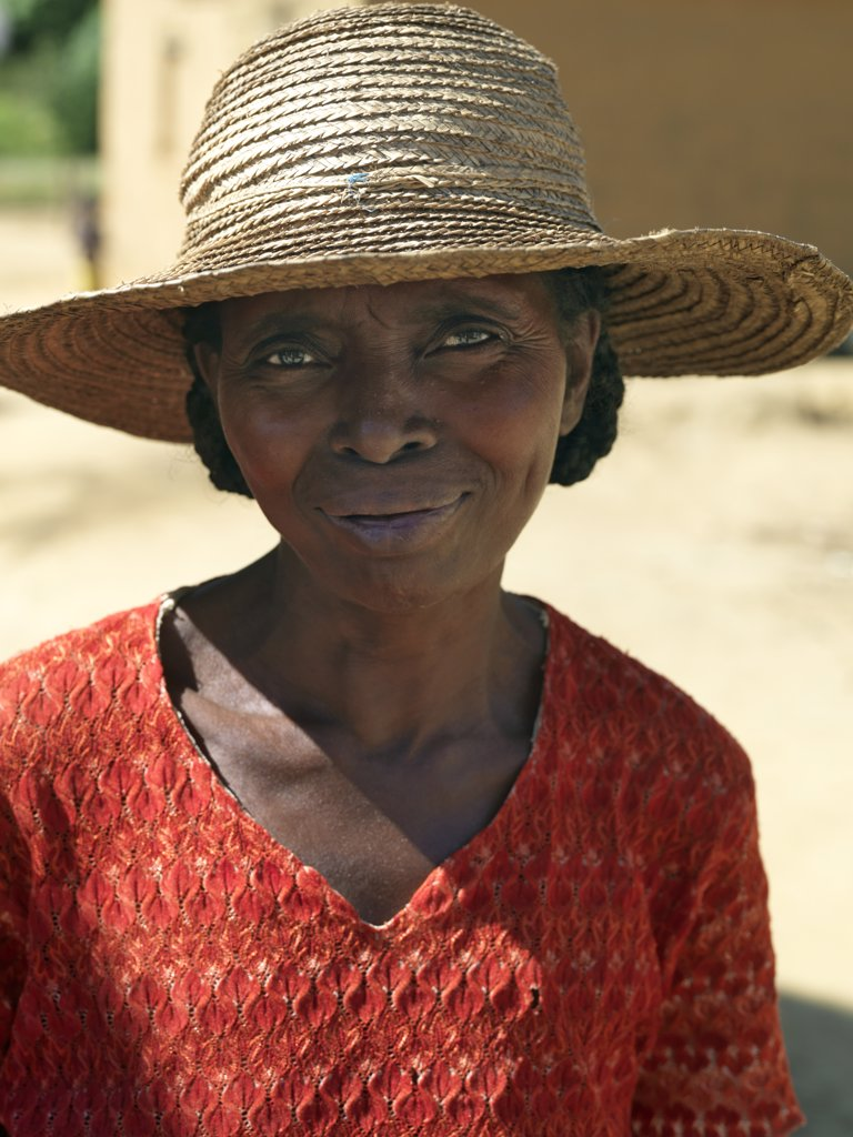 Stock Photo: 4272-20304 A Malagasy woman wearing a locally made raffia hat.