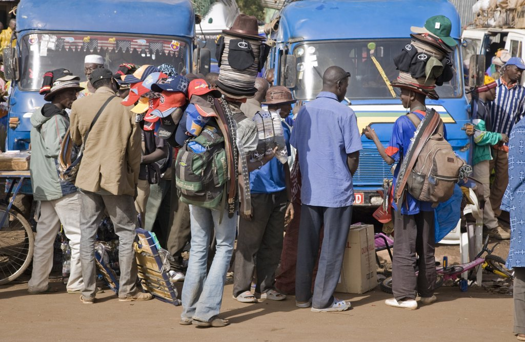 Stock Photo: 4272-20421 Mali, Bamako. Hat sellers at one of Bamako's country bus stations where well-loaded vehicles leave for various destinations in the country when they are full.