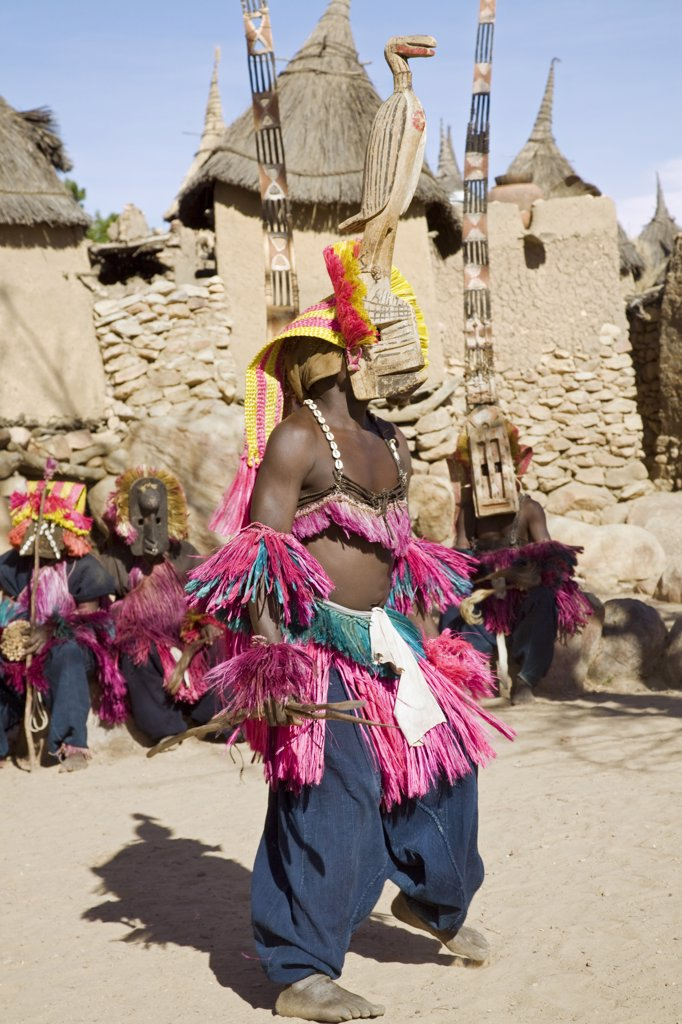 Stock Photo: 4272-20559 Mali, Dogon Country, Tereli. A masked dancer performs at the Dogon village of Tereli. Tereli is situated among rocks at the base of the spectacular 120-mile-long Bandiagara escarpment.  The mask dance is staged at funeral ceremonies to appease the dead and speed them on their way to the ancestral world.