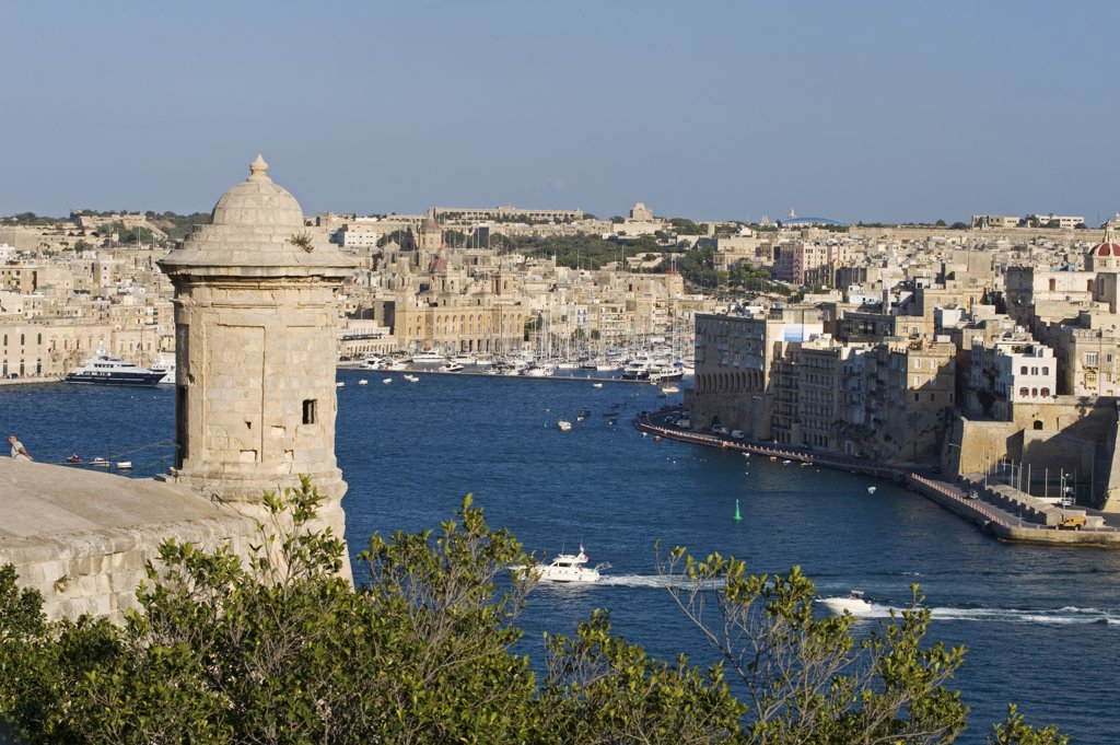 Stock Photo: 4272-21146 Malta, Valletta. A medieval sentry post built on to the great defensive walls surrounding Valletta looks out over the Grand Harbour towards Vittoriosa.